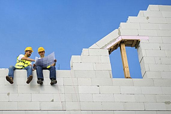 building contractors discussing construction plans