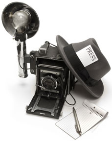 news reporter equipment - press pass, notepad, pen, and vintage camera